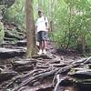 Dennis standing on the treacherous hiking terrain.