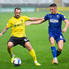 Picture: Epic Action Imagery <br /> <br /> Burton Albion v AFC Wimbledon - SkyBet League One - 24/10/2020<br /> <br /> Pictured: Neal Eardley of Burton Albion on the ball as Anthony Hartigan of AFC Wimbledon comes in for a challenge during the SkyBet League 1  match between Burton Albion and AFC Wimbledon at the Pirelli Stadium on Saturday 24th October 2020.