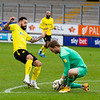Picture: Richard Burley/Epic Action Imagery <br /> <br /> Burton Albion v Hull City - SkyBet League One - 06/02/2021<br /> <br /> Pictured: George Long (Hull City) grabs the ball in front of the advancing Kane Hemmings (Burton Albion) during the SkyBet League 1  match between Burton Albion and Hull City at the Pirelli Stadium on Saturday 6th February 2021.