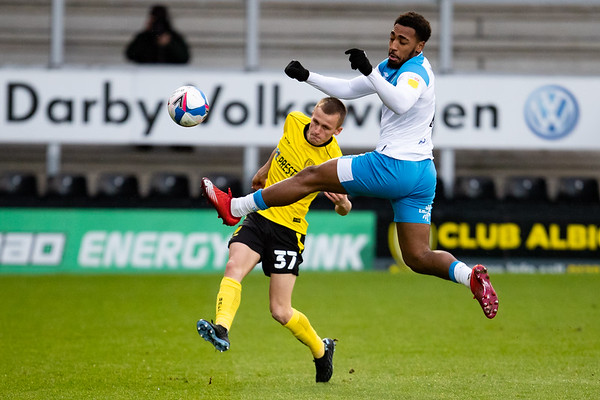 Picture: Richard Burley/Epic Action Imagery <br /> <br /> Burton Albion v Hull City - SkyBet League One - 06/02/2021<br /> <br /> Pictured: Debutant Tom Hamer (Burton Albion) clears the ball during the SkyBet League 1  match between Burton Albion and Hull City at the Pirelli Stadium on Saturday 6th February 2021.