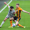 Picture: Alex Dodd/Epic Action Imagery <br /> <br /> Hull City v Burton Albion - SkyBet League One - 14/11/2020<br /> <br /> Pictured: Burton Albion's Ryan Edwards battles with Hull City's Callum Elder during the SkyBet League 1  match between Hull City and Burton Albion a at the KCOM Stadium on Saturday 14th November 2020.