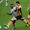 Picture: Alex Dodd/Epic Action Imagery <br /> <br /> Hull City v Burton Albion - SkyBet League One - 14/11/2020<br /> <br /> Pictured: Burton Albion's Niall Ennis vies for possession with Hull City's Jacob Greaves during the SkyBet League 1 match between Hull City and Burton Albion a at the KCOM Stadium on Saturday 14th November 2020.