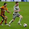 Picture: Alex Dodd/Epic Action Imagery <br /> <br /> Hull City v Burton Albion - SkyBet League One - 14/11/2020<br /> <br /> Pictured: Burton Albion's Stephen Quinn shields the ball from Hull City's George Honeyman during the SkyBet League 1 match between Hull City and Burton Albion a at the KCOM Stadium on Saturday 14th November 2020.