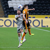Picture: Alex Dodd/Epic Action Imagery <br /> <br /> Hull City v Burton Albion - SkyBet League One - 14/11/2020<br /> <br /> Pictured: Burton Albion's Neal Eardley battles with Hull City's Callum Elder during the SkyBet League 1 match between Hull City and Burton Albion a at the KCOM Stadium on Saturday 14th November 2020.