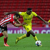 Picture: Alex Dodd/ Epic Action imagery<br /> <br /> Sunderland v Burton Albion - SkyBet League 1 - 01/12/2020<br /> <br /> Pictured: Burton Albion's Lucas Akins battles with Sunderland's Bailey Wright during the SkyBet League 1 match between Sunderland and Burton Albion at The Stadium of Light on Tuesday 1st December 2020.