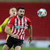 Picture: Alex Dodd/ Epic Action imagery<br /> <br /> Sunderland v Burton Albion - SkyBet League 1 - 01/12/2020<br /> <br /> Pictured: Burton Albion's Charles Vernam battles with Sunderland's Conor McLaughlin during the SkyBet League 1 match between Sunderland and Burton Albion at The Stadium of Light on Tuesday 1st December 2020.