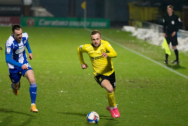 Picture: Richard Burley/ Epic Action Imagery<br /> <br /> Burton Albion v Wigan Athletic- SkyBet League One - 29/12/2020<br /> <br /> Pictured: Charles Vernam (Burton Albion) strides into attack with Will Keane (Wigan Athletic) in pursuit during the SkyBet League One match between Burton Albion and Wigan Athletic at the Pirelli Stadium on Tuesday 29th December 2020.
