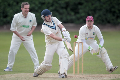 Daniel Thirkell lifts the ball over the wicket keeper for four more runs.