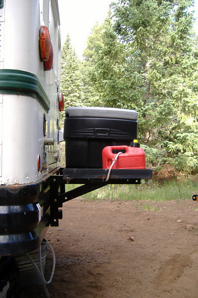 """Using the 2"""" x 2"""" x 3/16"""" angle iron from the deck support, I relocated the deck to a higher position, and installed a 48-gallon Action Packer box. <br /> 3/8"""" Grade 8 nuts & bolts fasten the parts together, and fasten everything to the bus bumper."""