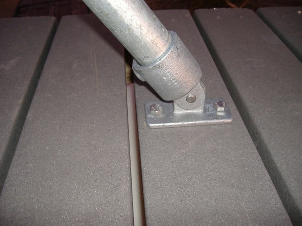 "Kee Klamp flanges and 3/8"" stainless hardware secure the support poles and mast to the deck."