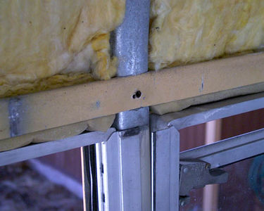 Another thing I have been considering is the insulation. While there is indeed insulation between the metal exterior skin and the interior metal skin...those 2 skins are connected by steel studs, which means there is an efficient thermal bridge between the outside and the inside walls.  Here is a picture detailing a stud, insulation, and window frame.
