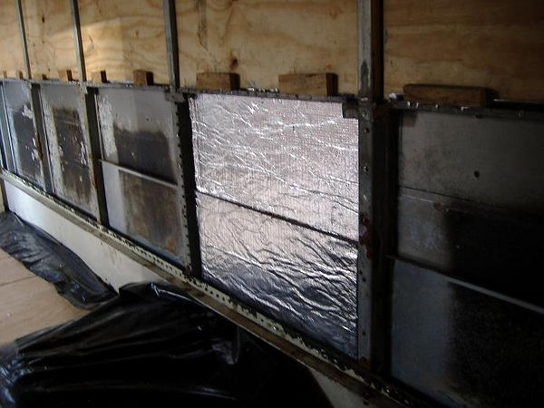 "Bonded Logic Insulator installed between bus ribs.<br /> Yes, there is a foil face on both sides. You can order single or double foil faces.<br /> <br /> The insulation is very easy to cut with normal shears, and does not require the user to wear protective clothing. Cotton batt insulation from Bonded Logic comes in 2 sizes: 3/8"" and 3.5"". Our wall thickness will be around 2 inches total, so we're going to make a sandwich using cotton insulation and foam board."