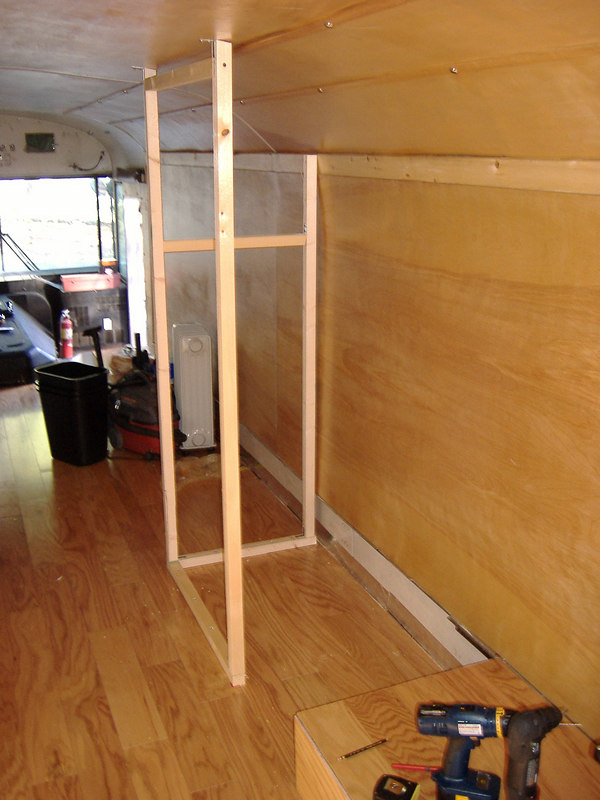 """Beginning of bathroom build-out.  Similar to kitchen and shower build-outs; we used 2"""" x 2"""" framing and 3/8"""" plywood walls.  <br /> <br /> Looking forward."""