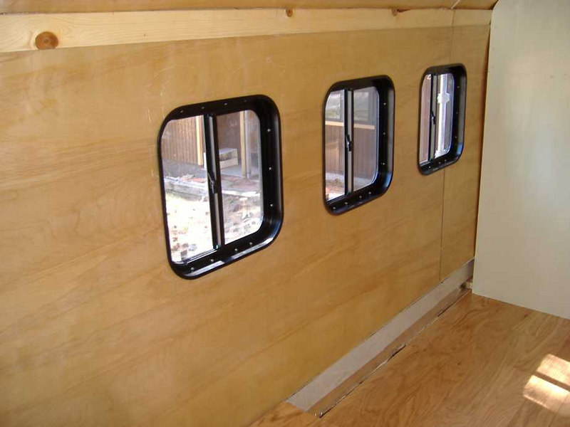 "The three Hehr model 5900 windows on the passenger side.  (Same steps as used <a href=""http://seanf.smugmug.com/gallery/1249678"" target=""_new"">here</a>.) The wall at right is the bathroom wall."