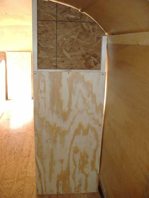 Upper panel of OSB on the shower side of the forward wall.  The gap at the top isn't much concern since it will be covered with FRP.