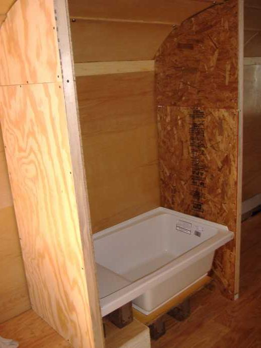 The completed shower enclosure.  The FRP will be glued directly to the OSB (sides) and birch paneling (back).  But that comes after all of the incoming & outgoing plumbing is installed and tested.  We'll also finish the front of the tub at that time.