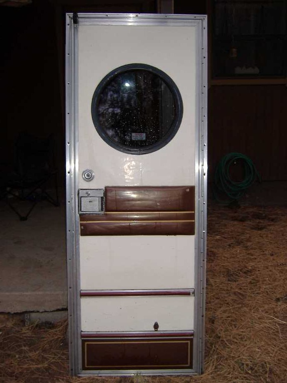 """This will be the new front door.  This baby came from a 1982 Vogue RV.  Dig the round window. This was purcahsed from <a href=""""http://www.azrvinc.com/"""" target=""""_new"""">Arizona RV Salvage</a> in Phoenix."""