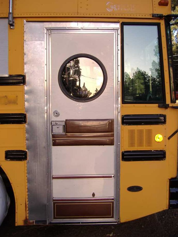 To bridge the gap between the bus skin and the door frame, we attached 26GA sheet steel using self-drilling screws.