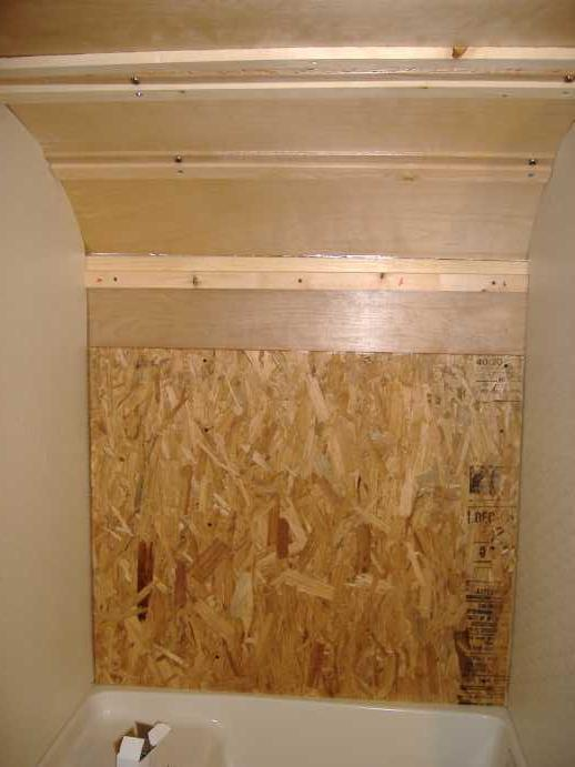 "Panel of 5/8"" OSB to bring the back even with the sides.  After this photo was taken we added 2 6"" wide pirces of OSB in the ceiling curve for more anchoring surface area."