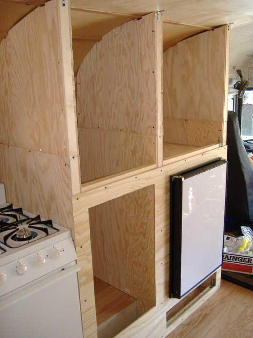 "Lower front panel attached.  The fridge will need to be removed for primer & paint.<br /> There is a snug fit between the stove and pantry wall.<br /> <br /> We later added 2"" x 2"" horizontal supports at the top of the dividing walls to attach the upper pantry front wall panel."