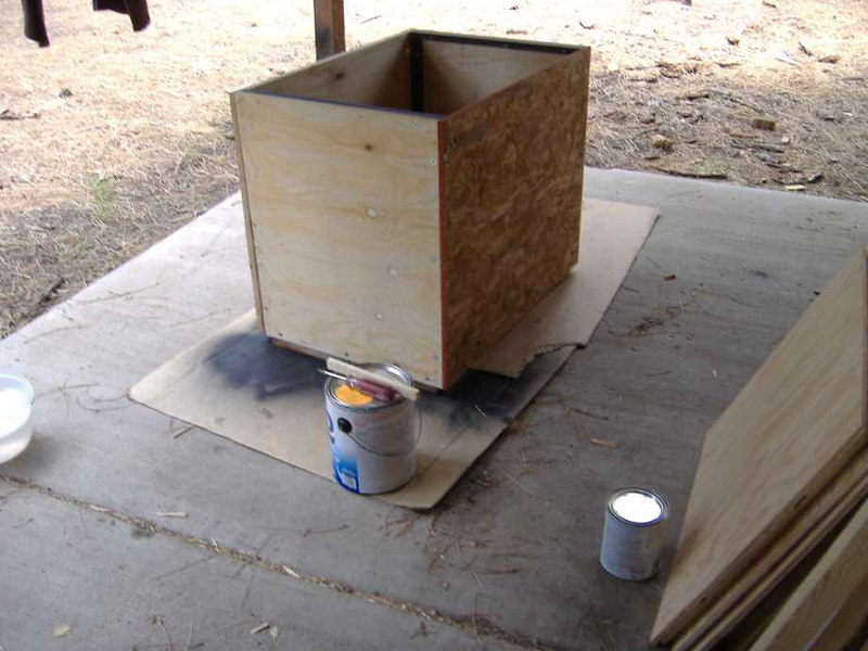 "Next we fabricated a box from materials leftover from previous projects:<br /> 3/4"" plywood bottom<br /> 5/8"" plywood sides<br /> 5/8"" OSB top<br /> 3/4"" pine back panel<br /> 1"" angle iron frame<br /> <br /> The box interior dimensions are 30"" wide, 20"" high, and 28"" deep."