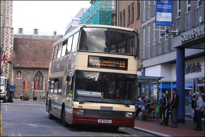 Sporting the old Reading Buses livery Optare Spectra 711 (S879BYJ) heads down Market Place, Reading on route 55 to Woodley – 4 September 2007.