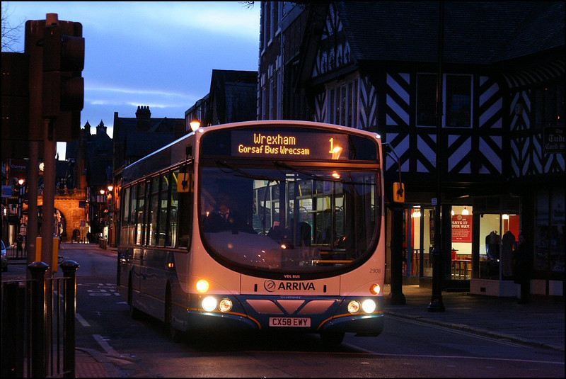 With the light fast fading, Arriva Cymru VDL 2908 (CX58EWY) makes its way down Foregate Street, Chester on service 1 to Wrexham - 8 March 2009.