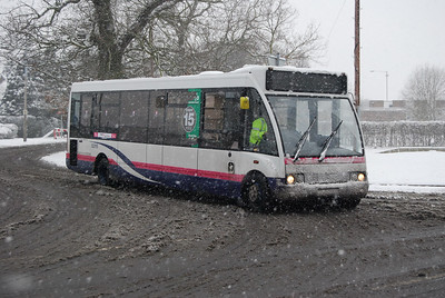 Yes, some of us are stupid enough to stand around in blizzards photographing buses...