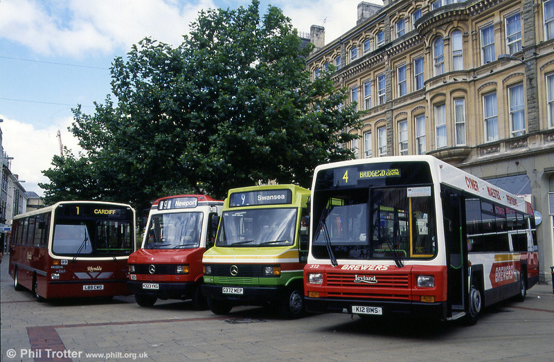Brewers 512 (K12 BMS), a 1992 Leyland Lynx B52F leads a line-up of other operators' vehicles in Cardiff. The others (left to right) are: Rhondda 89 (L89 CWO), a 1993 Dennis Dart/Wright B35F; Red & White 323 (K323 YKG), a 1993 Mercedes 811D/Wright B33F and SWT 372 (G372 MEP), a rebodied Mercedes 814D.