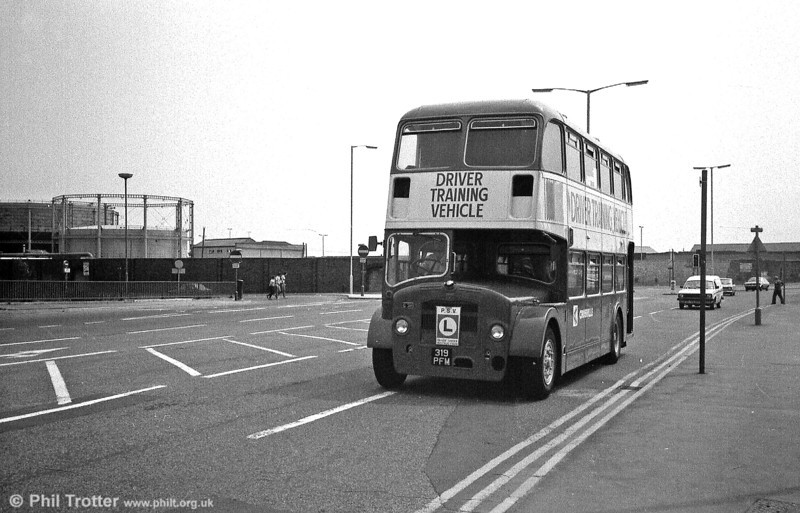 A further view of FS6G DFF38 (319 PFM) heading up West Way, Swansea. A Tesco store now occupies the site of the gasworks, seen in the background.