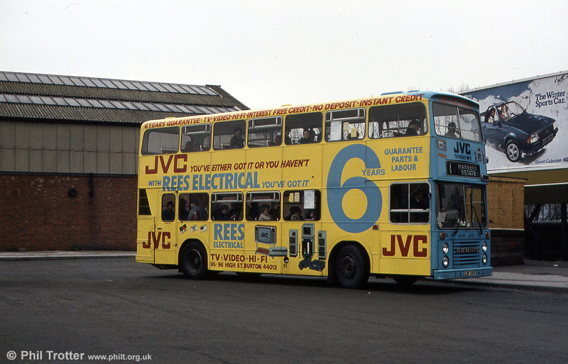 Fleet number 31 (LBF 231V), a Dennis Dominator/East Lancs H43/32F, seen here carrying an advertising livery.