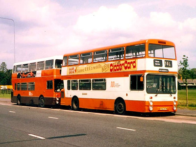 "7342 (YNA297M), a ""standard"" Northern Counties bodied Daimler Fleetline at Southern Cemetery Bus Station, screened for a Works Service and seen in original orange and white livery, 4th June 1983"