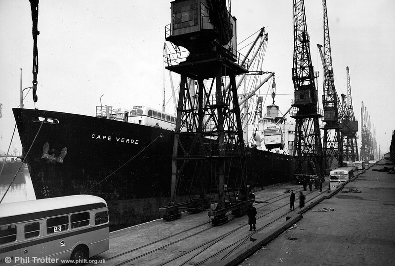 Loading new vehicles aboard the MV (SS?) Cape Verde at the Port of London. Note that during transit vehicles appear to carry their fleet nos. on paper notices in the windows.
