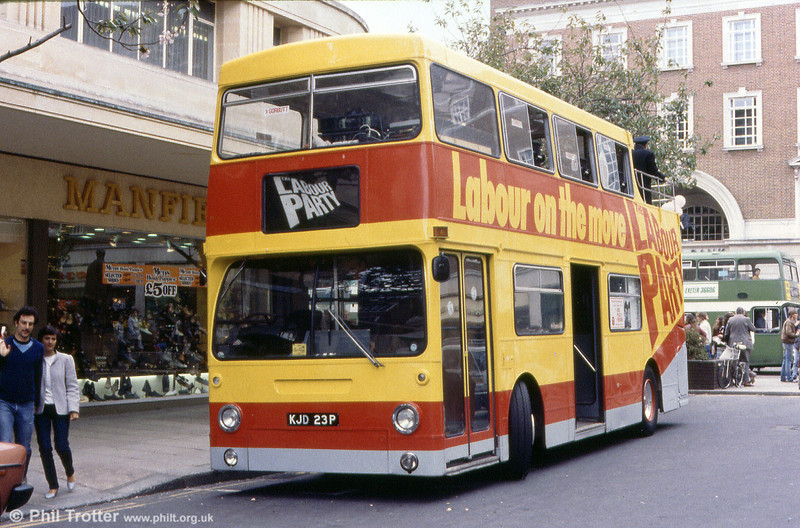 Former London Transport DMS2023 (KJD 23P) performing a non-PSV activity as a Labour Party 'Battle Bus' in Bristol City Centre.