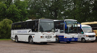 Poppletons of Pontefract Plaxton bodied Volvo B10M 552CTF and Van Hool bodied Volvo B10M 253FPP at Yorkshire Sculpture Park on 22nd June 2012, with Stringers Mercedes Benz 0814D/Plaxton PX55AHA also in shot.