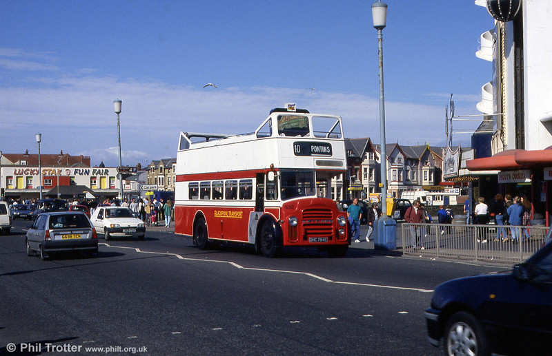 Blackpool open top 532 (DHC 784E), ex-Eastbourne 84, is a Leyland PD2A/East Lancs H32/28R, seen approaching the Pleasure Beach in April 1994.