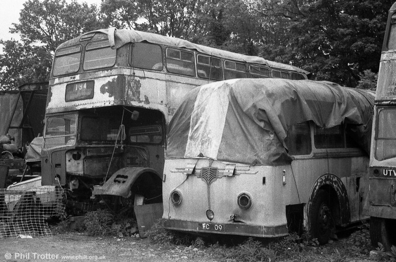 Beneath the tarpaulin is Oxford 609 (SFC 609) a 1952 AEC Regal IV/Willowbrook C37C. Alongside is 194 (194 BFC) an AEC Regent V/Weymann L30/28RD of 1957.