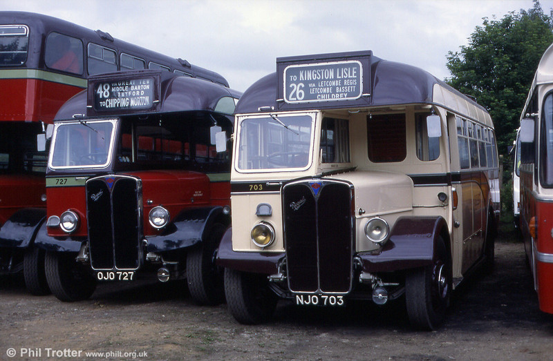 Former City of Oxford 703, an AEC Regal III (9621A624)/Willowbrook DP32F NJO 703 at the Oxford Bus Museum. Alongside is OJO 727, a bus-specification example.