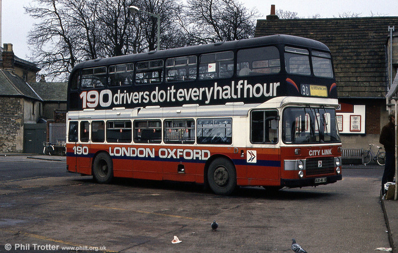 City of Oxford Bristol VRT/ECW H43/31F 461 (AUD 461R) photographed at Oxford Gloucester Green in March 1984 with a novel advertisement for the Oxford - London coach service.