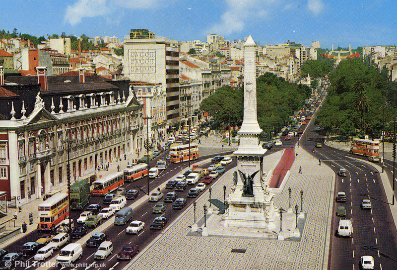 A commercial postcard showing Restorers Square in Lisbon with an AEC Regent III (in green livery) Regent Vs, a Regal III and a Daimler Fleetline.
