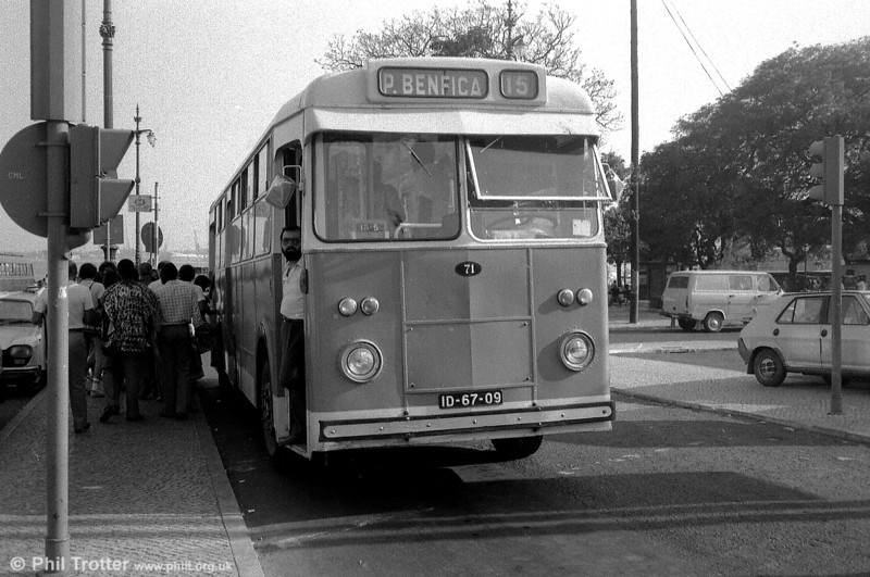 The driver of Carris Guy Victory 71 (ID-67-09) takes an interest in goings on while passengers board at the rear. These vehicles had a large rear platform and were originally crew operated with a seated conductor. These all ran as Daimlers.