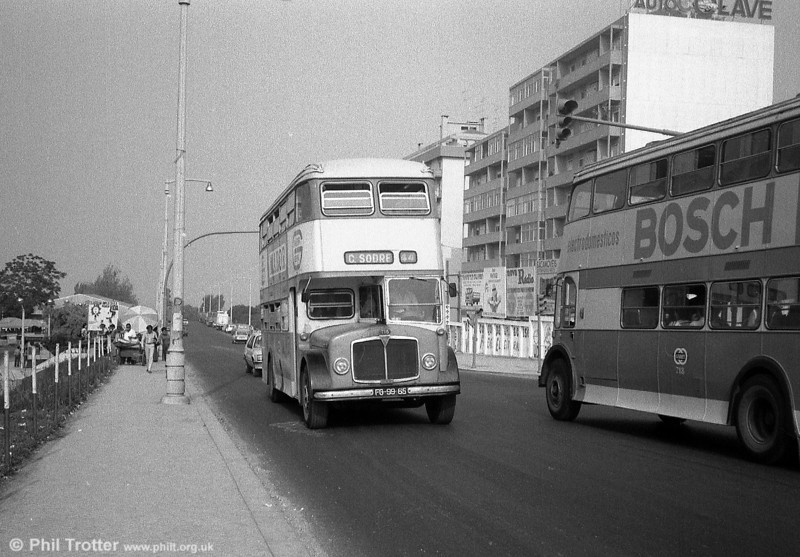 AEC Regent V 718 (FG-99-65) passes a sister at speed in a Lisbon suburb.