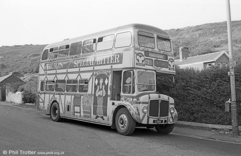 In 1972, 1962-built AEC Regent V/Willowbrook H39/32F 571 (11 BWN) was repainted in an overall advertisement for Truman's Beers, as seen here at Limeslade on 28th July 1973.