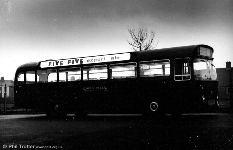 An evening shot of 952 (895 DCY), a 1963 Leyland Leopard/Marshall B53F illustrating the illuminated offside advert.