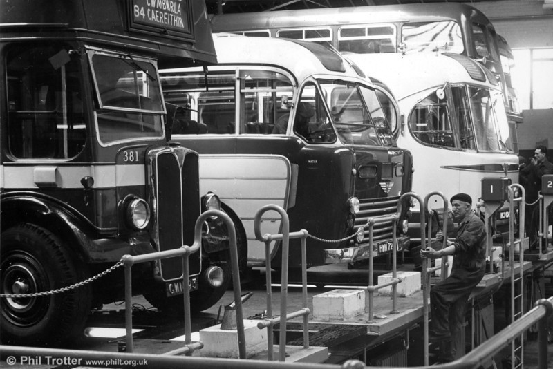 A view inside the workshop at Ravenhill. Present are AEC Regent III/Weymann 381 (GWN 83), An AEC Regal IV/Windover, an AEC Reliance/Weymann Fanfare and Willowbrook and Weymann bodied AEC Regent Vs.