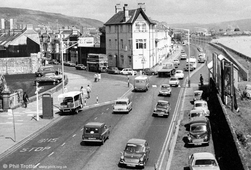 An unidentified United Welsh Bristol LD6G/ECW H33/27R at the Slip, Swansea, heading for Pennard on route 64 during the 1960s. Products of the British motor industry are in abundance!