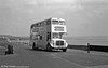 <DIV ALIGN=left>AEC Regent V/Weymann H39/32F 530 (SWN 993) approaching Oystermouth on service 85 from Caswell Bay to the Town Centre, Alexandra Road. This route ran every twenty minutes via Derwen Fawr and Sketty and prior to 1960 would have connected with the Mumbles Railway at Oystermouth. Swansea's sea air was in fact a good test for the vehicles and the only severe long term corrosion was in the steel canopy above the bonnet which was treated with silver cellulose paint.  Most alarmingly there was an unexpected safety hazard; in certain lighting conditions, presumably associated with foggy weather, the unpainted buses would be difficult to see.</DIV>