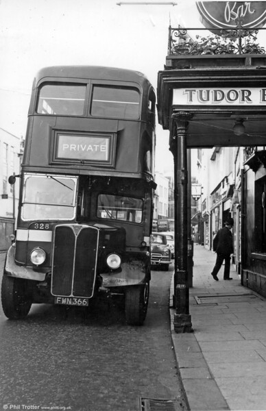 Almost...! AEC Regent III 323 (FWN 366) demonstrates one of the roadside hazards for unwary drivers in High Street, Swansea.