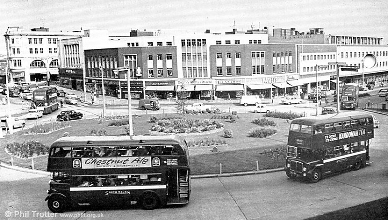 A 1960 scene at Kingsway Roundabout with two AEC Regent IIIs and two Regent Vs.