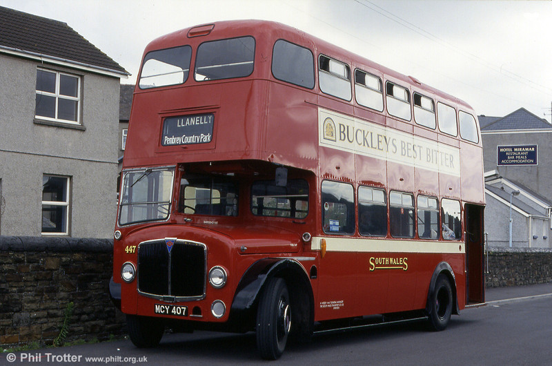 <DIV ALIGN=left>AEC Regent V 447 (MCY 407) again at Llanelli Station. Further high bridge examples were delivered in 1956 (460-480, NCY 451-471) and 1957 (481-500, OCY 664 -683). These were all of the Weymann type except 491-500 which were of the rounder appearance Willowbrook design. By now the Four Hundreds formed a sizeable part of the SWT fleet and could be found on a variety of work. In Swansea they will be best remembered for shuttling back and fore between Alexandra Road and Sketty (later Sketty Park) on route 74 or crawling across Townhill on crowded summer services from Morriston to Caswell Bay.</DIV>
